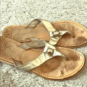 Used Coach silver flip flops
